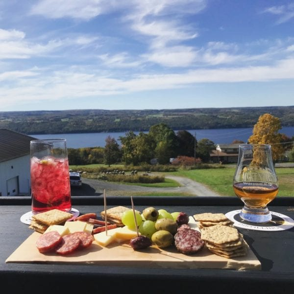 A small bite and drink from Finger Lakes Distillery looking over Seneca Lake.